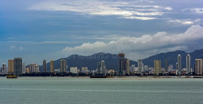 Land reclamation in front of George Town, Penang, Malaysia. Self Discharging Sand Carrier barge anchored in front of land reclamation site in George Town royalty free stock photos