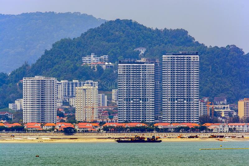 Land reclamation on George Town shore, Penang, Malaysia. Penang coastal land reclaiming activity at Gurney drive, which involves the construction of a new stock photo