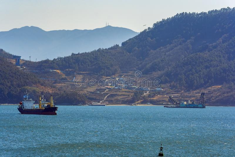 Land reclamation in Gwangyang bay, South Korea. Cutter suction dredger at work of land reclamation in Gwangyang quay, Jeonnam, Korea stock images