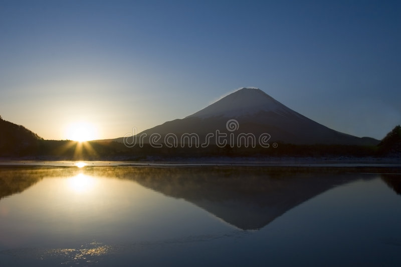 Land of the Rising Sun. Lakeside view of Mount Fuji with rising sun stock photo
