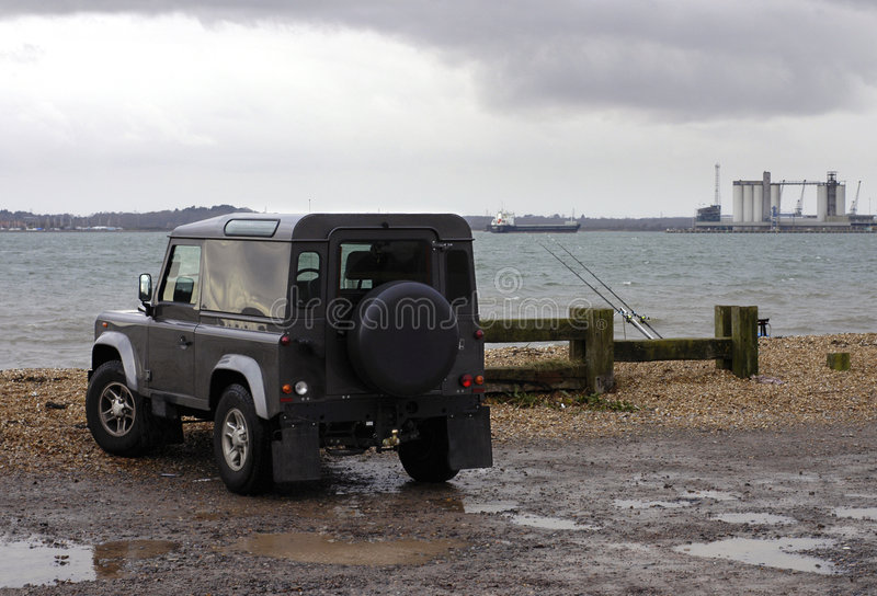 Land Rover by bay royalty free stock photos