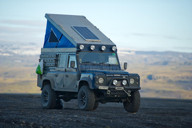 Land Rover Defender overland camper stock photography