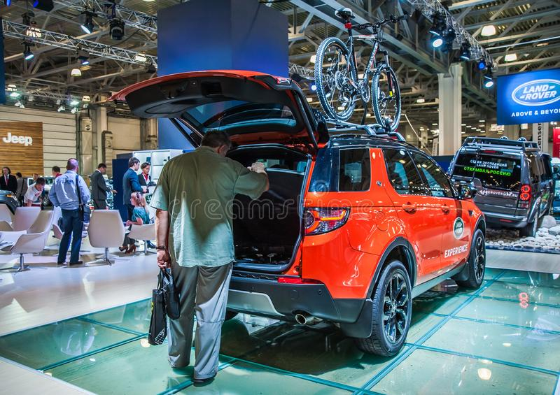 Land Rover Discovery Sport with open trunk and bikes on the roof royalty free stock image
