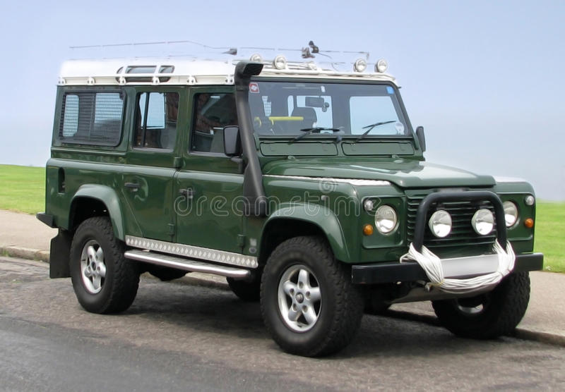 Land rover jeep county station wagon. Photo of a green long-wheel-base Land Rover jeep with winch and rescue equipment royalty free stock photos