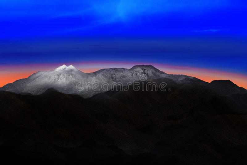 land scape of snow mountain hill with beautiful dramatic colorful sky before morning dawn light use for nature background and stock photos