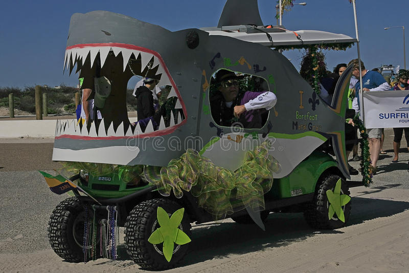 Land Shark Alert at the Barefoot Mardi Gras Parade. One golf cart owner decorated his golf cart as a shark trolling for food at the Barefoot Mardi Gras Parade royalty free stock photos
