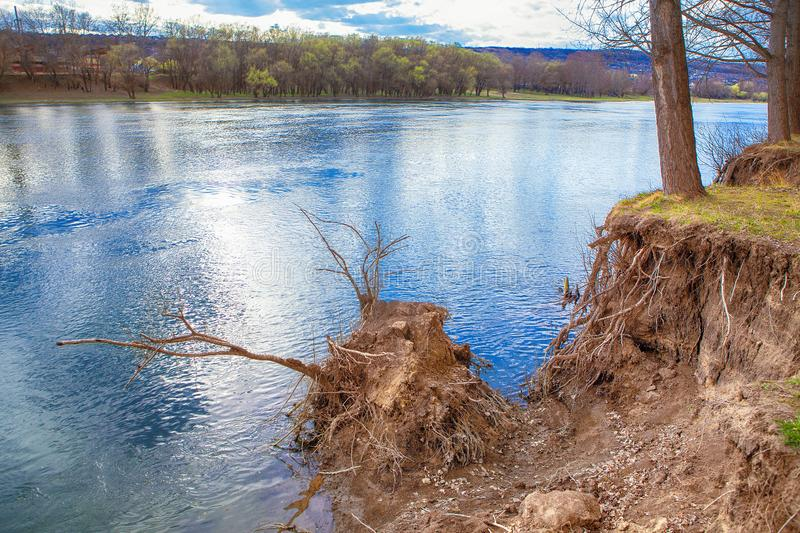 Land sliding on the bank of the river. Natural scenery with land sliding of river shore stock photos