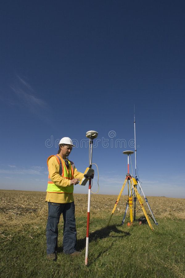 Free Land Surveyor Working With GPS Royalty Free Stock Photos - 4437888