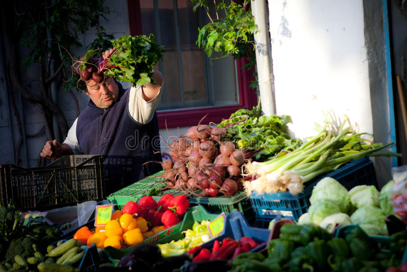 Landbouwer bij Markt stock afbeeldingen