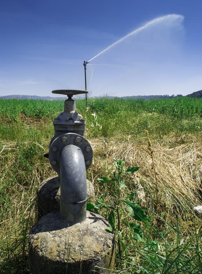 Landbouwirrigatiesystemen stock afbeeldingen