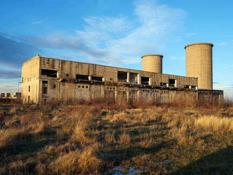 Industrial ruins at sunset. Landcape with industrial ruins at sunset royalty free stock image