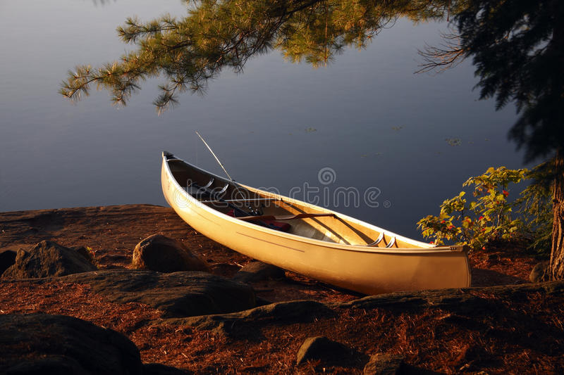 Landed Canoe. A canoe up on the shore at a camp site