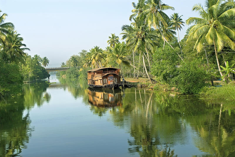 Landed houseboat at backwaters. Travel- Backwater tourism- Houseboats or Kettuvallams are made usually with locally available timber, wooden planks and held royalty free stock photography