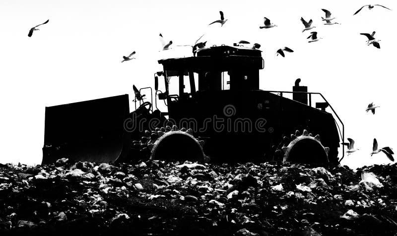 Landfill Dozer Silhouette. Landfill bulldozer, rubbish, plant and equipment, consumerism, sustainability, food, Heavy royalty free stock image