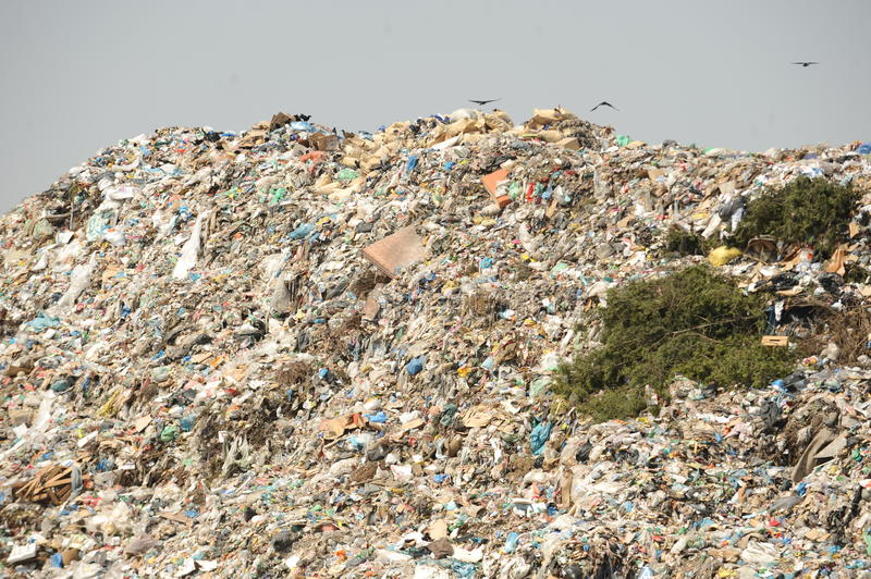 Landfill site. Disposal of waste materials in a garbage dump royalty free stock photos