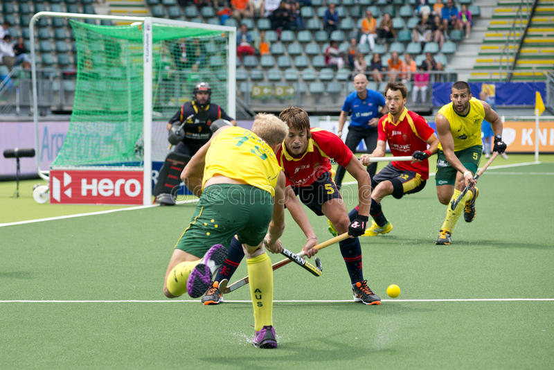 Landhockeyhandling AUS vs ESP royaltyfri foto