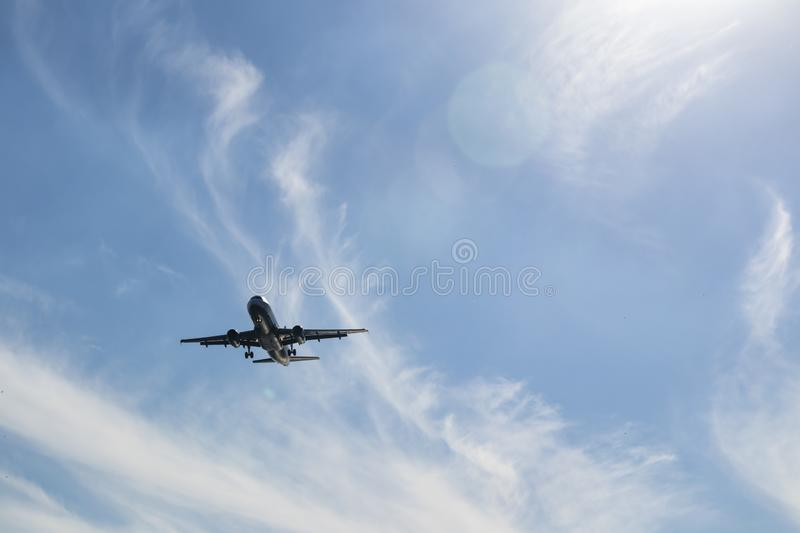 Air plane and blue sky. Landing air plane and blue sky royalty free stock images