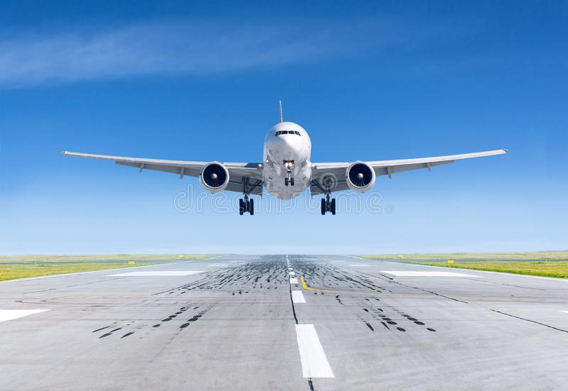 Landing airplane exactly on the runway airport.  royalty free stock images