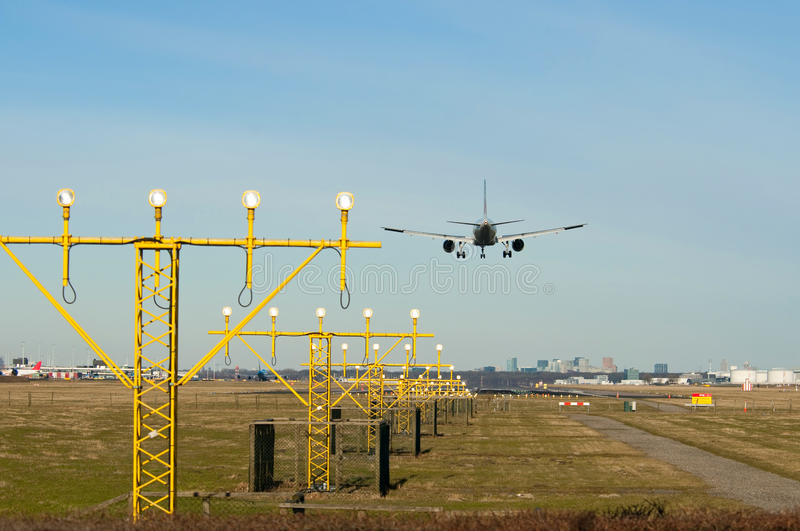 Download Landing Airplane With Lights Stock Image - Image: 14228161