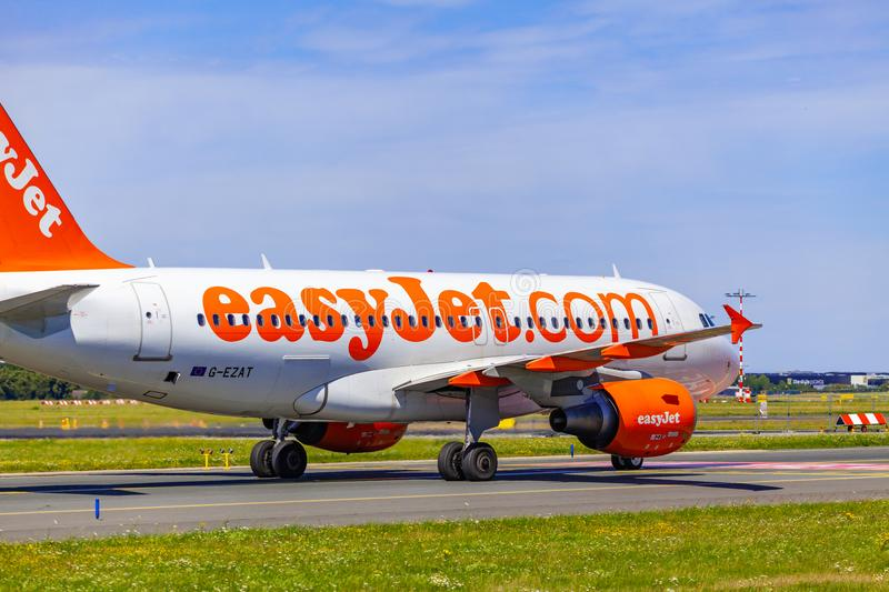Landing and Arrivals on Vaclav Havel airport, Prague, Easy Jet Airbus A319-111 from behind. CZECH REPUBLIC, Prague - 2018/07/07: Landing and Arrivals on Vaclav stock image