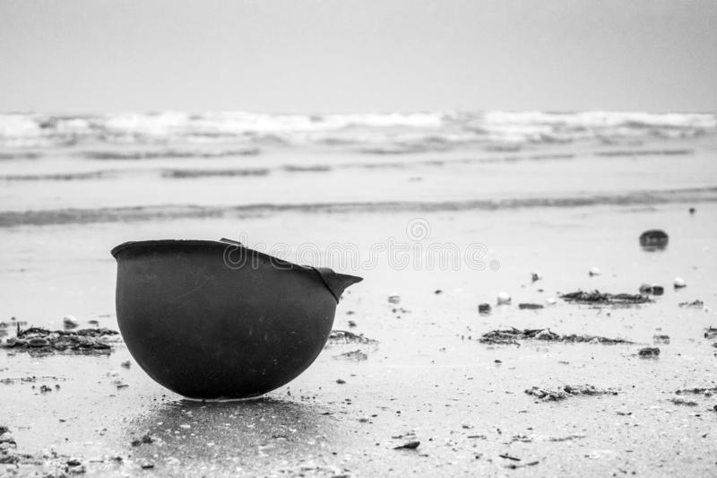 Landing beaches of june 6, 1944 in Normandy. Utah beach. Helmet of a parachutist on the sand. The longest day. stock photos