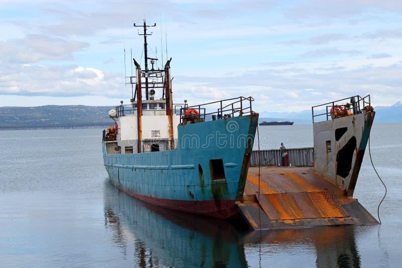 Landing craft on the beach royalty free stock photo