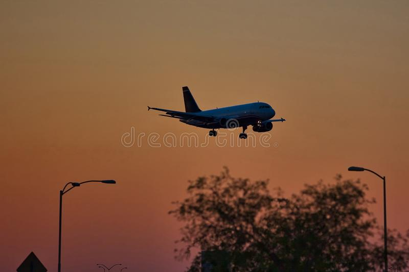 Commercial Jet on approach for Landing at Dusk royalty free stock photos