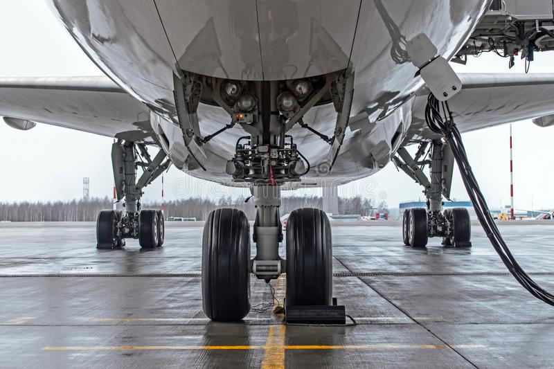 Landing gear and aircraft wheels parked at the airport, with basic power supply. royalty free stock photos