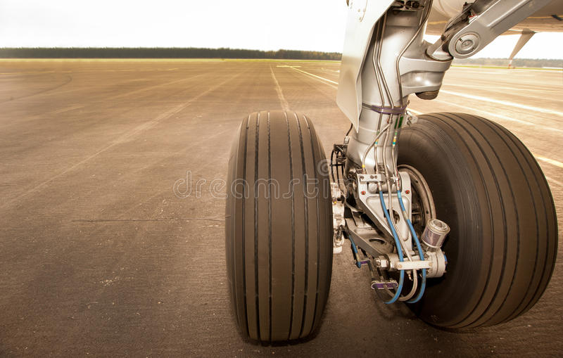Landing gear, wheels, on the runway, close up royalty free stock image