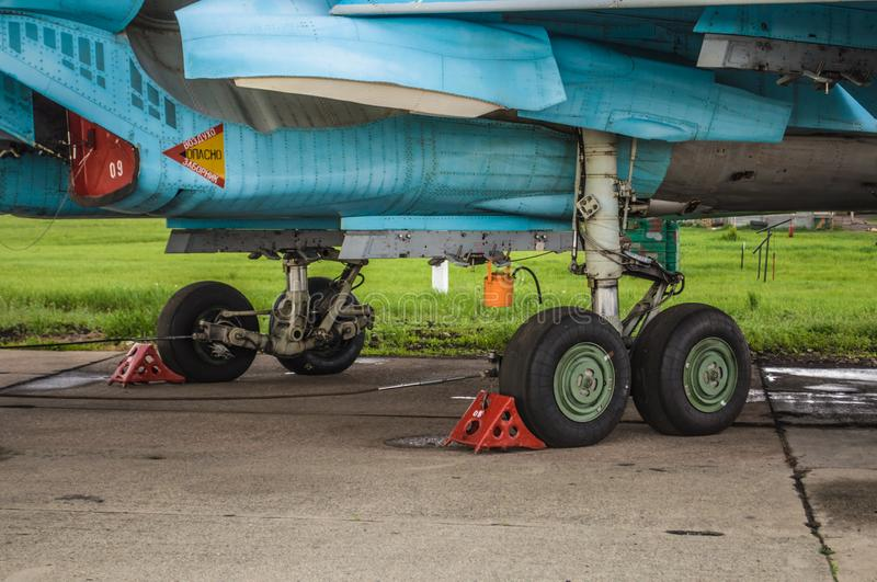 Landing gears and other detailes of military fighter bomber planes Su-34 royalty free stock photo