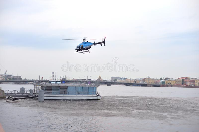 Landing a helicopter on a floating platform in the center of St. Petersburg. stock photography