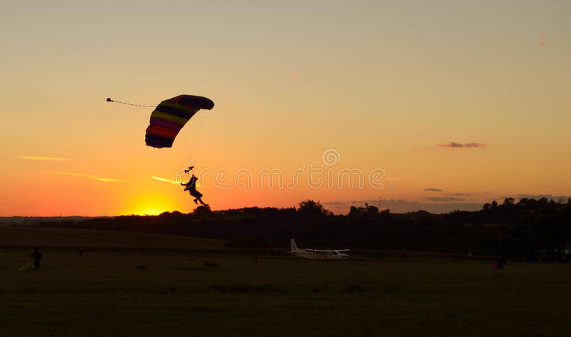 Landing parachute at sunset stock photo