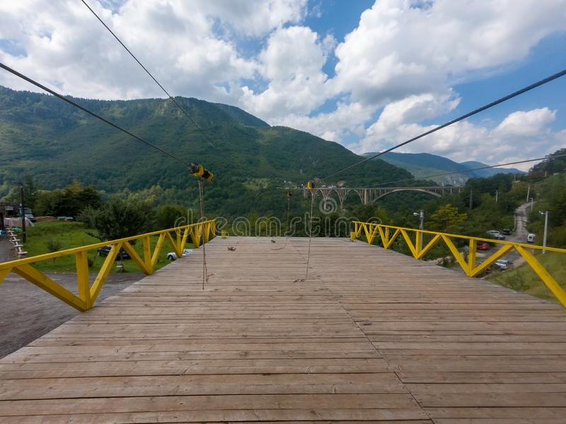 Landing platform for zip line - enjoying the adrenaline rush. Djurdjevic Tara bridge in Montenegro royalty free stock images