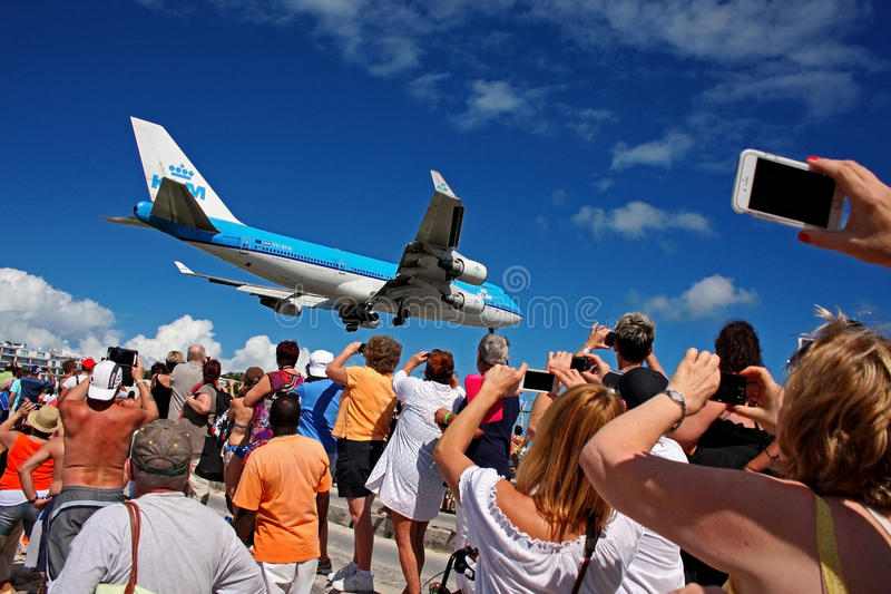 Landing at Princess Juliana International Airport - Saint Martin . KLM Boeing 747-400 landing at Princess Juliana International Airport - Saint Martin over stock photography