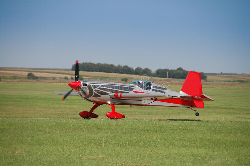 Landing of the small sports plane on the Vrsac airport upon completion of acrobatic flight stock images
