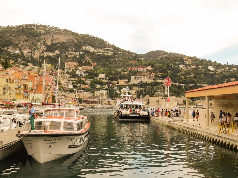 Landing of tourists in the port of Villefranche-sur-Mer on tender boats for transfer to a cruise liner royalty free stock photos