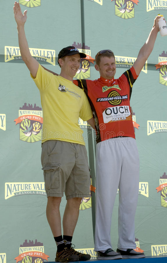 Landis on Podium for Most Aggressive Rider Jersey. Floyd Landis celebrates with his sponsor after winning the red jersey at the 2009 Nature Valley Grand Prix in stock photos