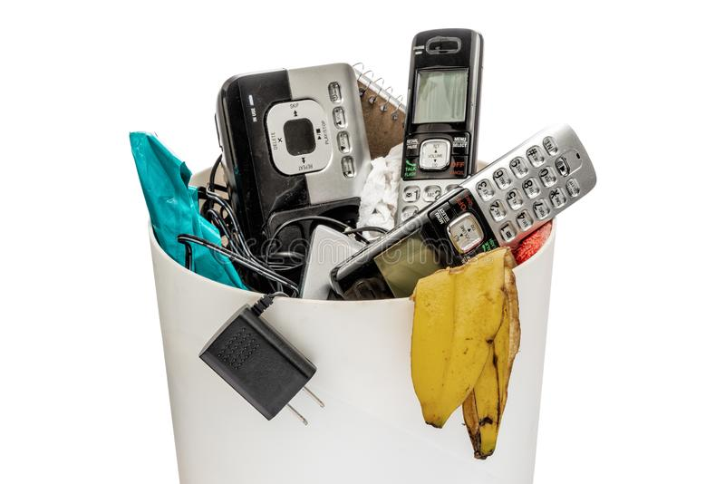 Landline Telephones In The Trash stock photography