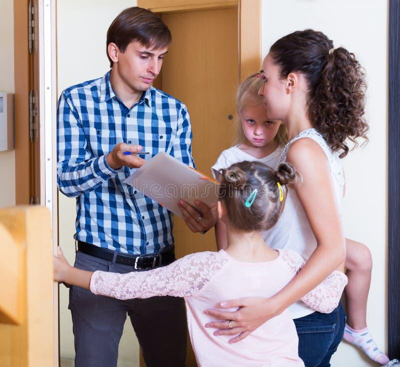 Landlord asking family for money royalty free stock image