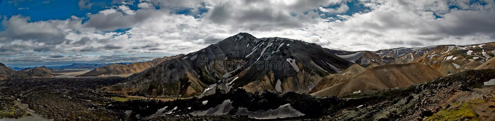 Landmannalaugar and lava field. Landmannalaugar is a high place of tourism in Iceland with rhyolite mountains , lava field and hot springs royalty free stock photography