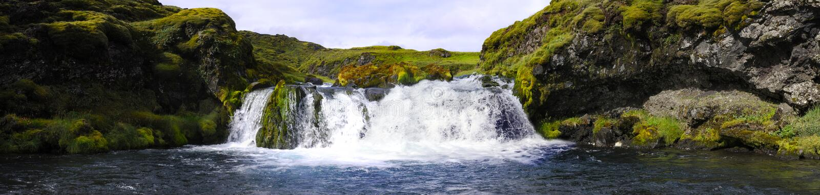Landmannalaugar waterfall. A small, hidden and obscured waterfall in the Icelandic National Park Landmannalaugar stock image