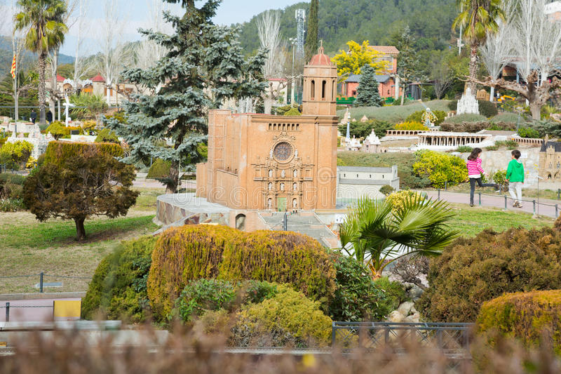 Landmark buildings displayed in scale model replica of Catalonia. BARCELONA, SPAIN - JANUARY 31, 2016: Sunny view at building models exhibitions in miniature royalty free stock image