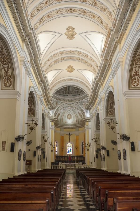 Landmark Cathedral Center Aisle and Interior. San Juan, PUERTO RICO - August 4, 2018: Interior of landmark Metropolitan Cathedral Basilica of Saint John the royalty free stock image