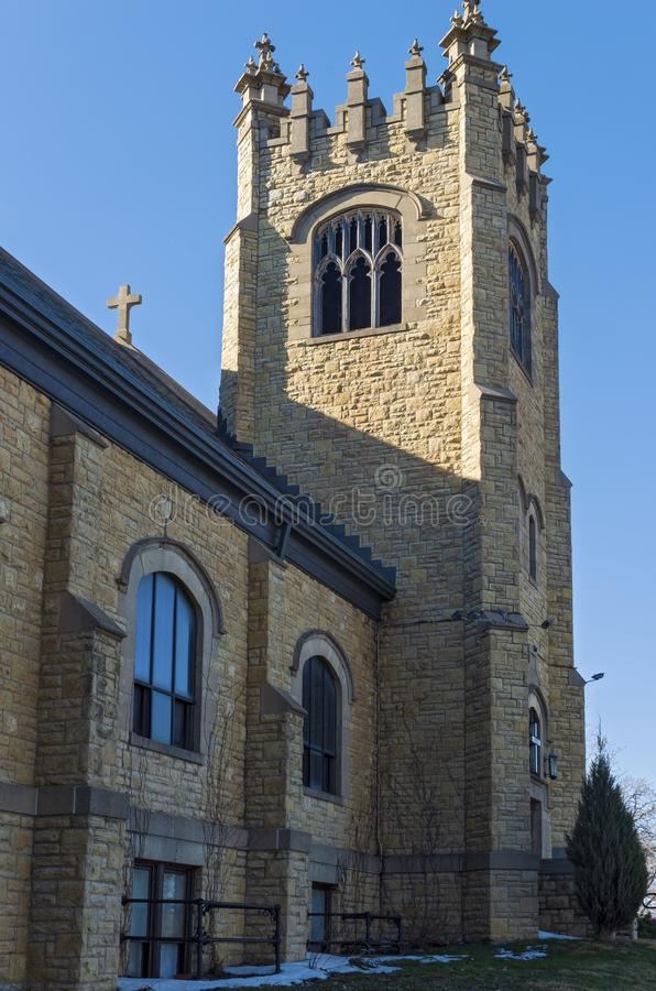 Landmark Church Bell Tower and Nave in Saint Paul. Bell tower and nave wall exterior of gothic style church in saint paul minnesota stock photo