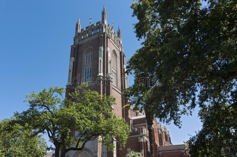 Landmark Church and Bell Tower in New Orleans. Church and bell tower of gothic revival style architecture in new orleans royalty free stock images