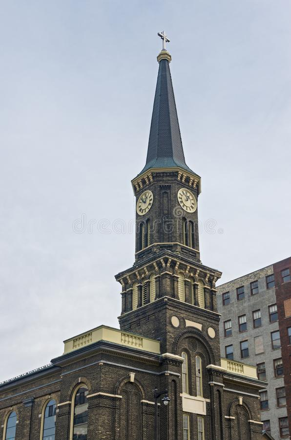 Landmark Church Bell Tower and Steeple in Milwaukee. Landmark church facade with bell tower and steeple in downtown milwaukee wisconsin royalty free stock photos