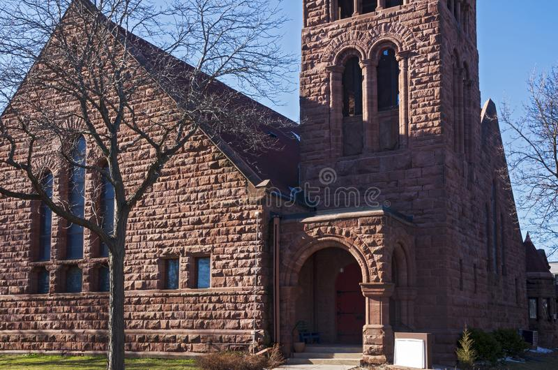 Landmark Church Corner Entrance and Bell Tower. Landmark church at corner and bell tower above entrance of richardsonian romanesque style architecture in saint stock images