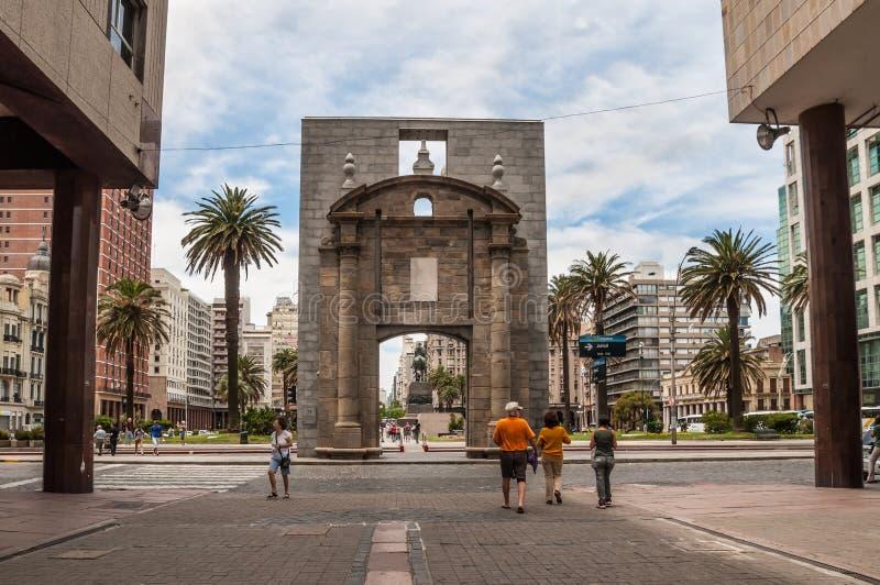 Landmark Citadel Gate - Puerta de la Ciudadela - Montevideo. Montevideo, Uruguay - December 15, 2012: People walking on Sarandi pedestrian street, in the Ciudad stock image