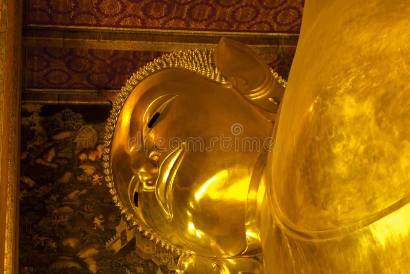 Landmark, Close Up Beautiful Big Buddha Reclining,Golden statue Temple Wat Pho in Asia Bankok Thailand. 2017 stock photo