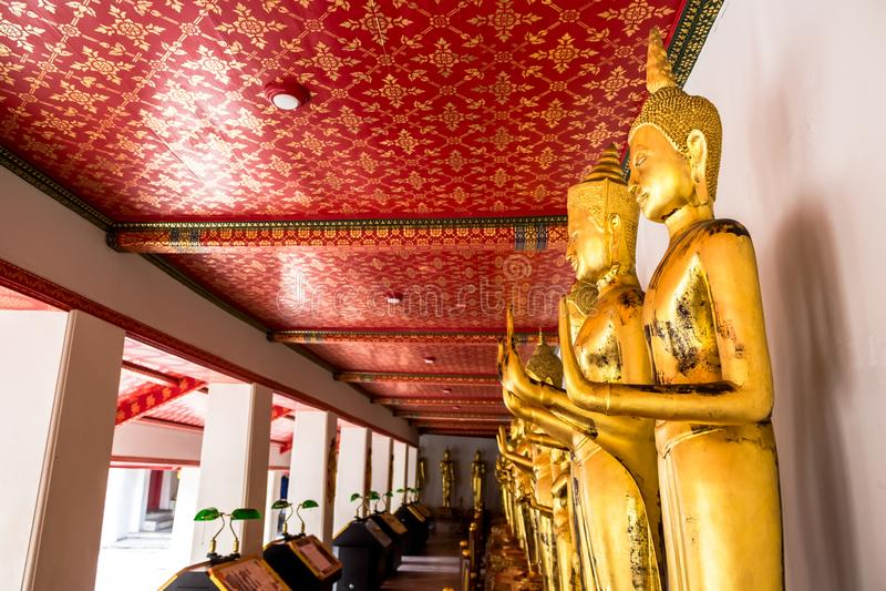 Landmark, Close Up Beautiful Black Buddha statue,standing Buddha statue,Golden statue Temple Wat Pho in Asia Bankok Thailand royalty free stock photography